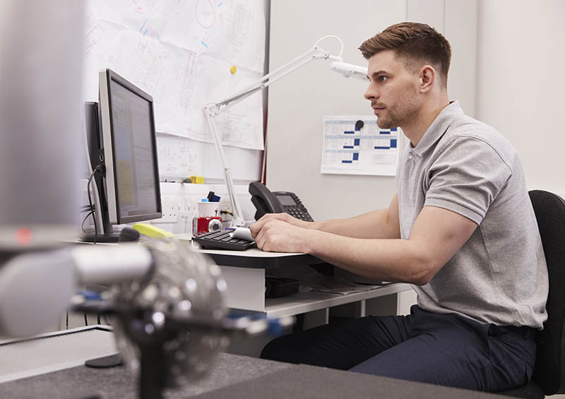 R&D Engineer designing at a computer screen