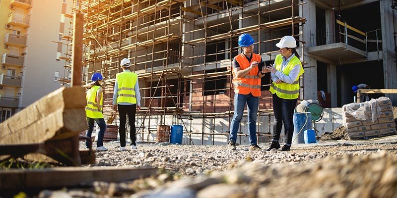 Four construction workers having meeting
