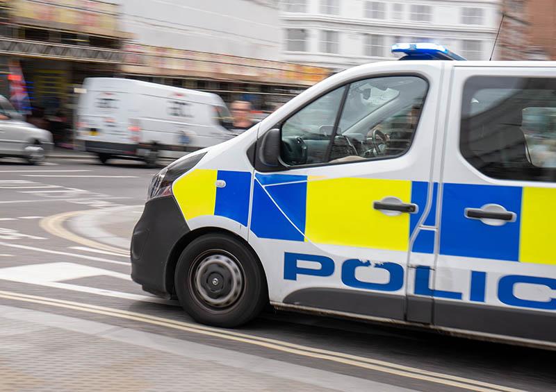 Police van patrolling street